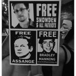 Snowden y Assange con Bitcoin